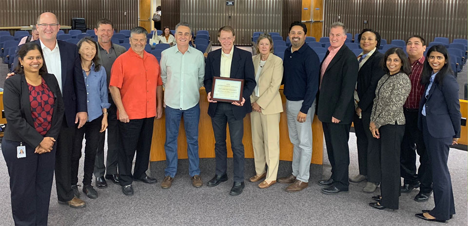 Commissioners and staff presented award